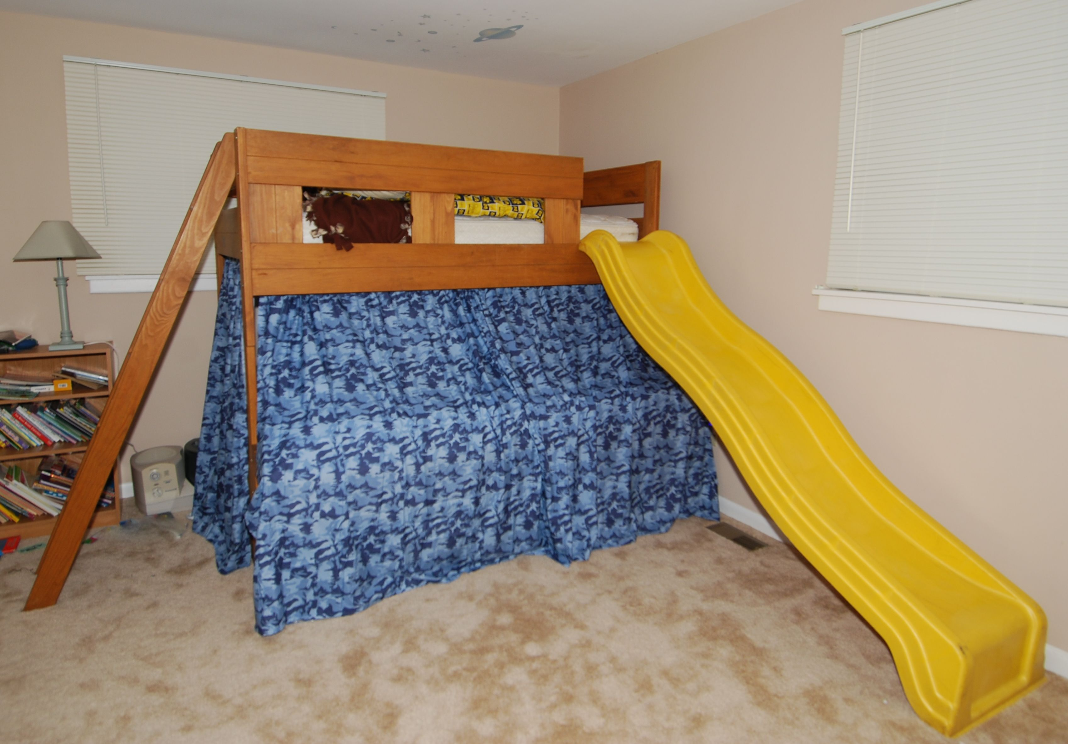 Kids metal loft bed with slide  Took regular bunkbed and added a slide u curtains for a tent to make
