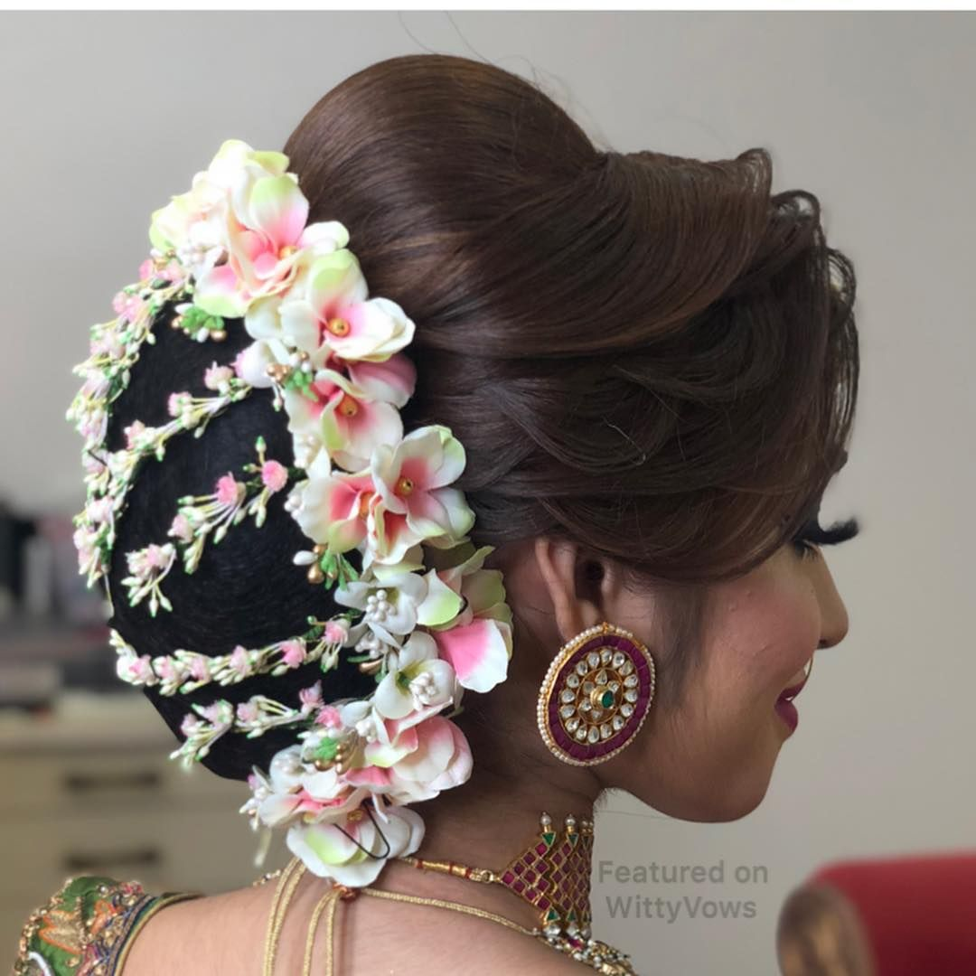Hairstyles Like This Drooling Over This Floral Bun That S A Totally Fresh On Bridal Hairstyle Indian Wedding Indian Bridal Hairstyles New Bridal Hairstyle