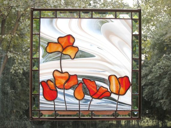 This is a stained glass panel (or a large suncatcher) with six red/orange poppy (or tulip) blooms. The tulips are made of a gorgeous textured