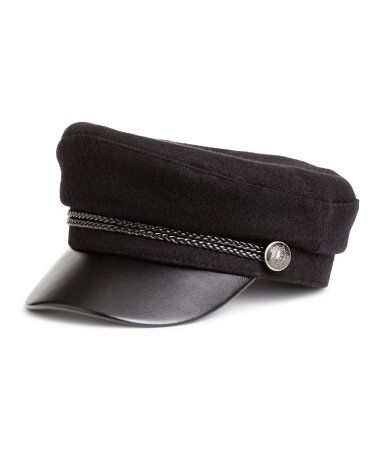 53254d63c33d2b Black. Captain's cap in woven fabric. Braided band at front and metal  buttons at sides. Lined.