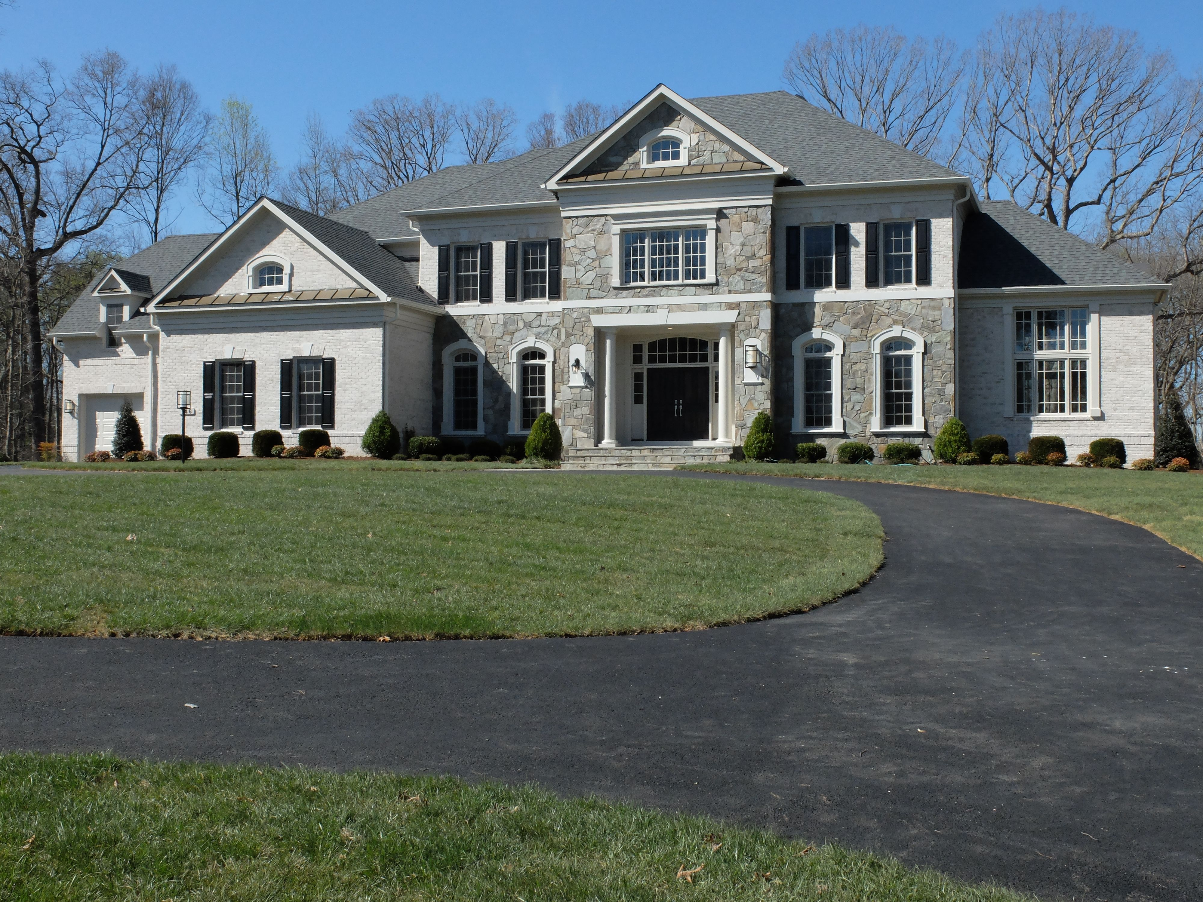 Custom home with stone and brick exterior. Gulick Group luxury home ...