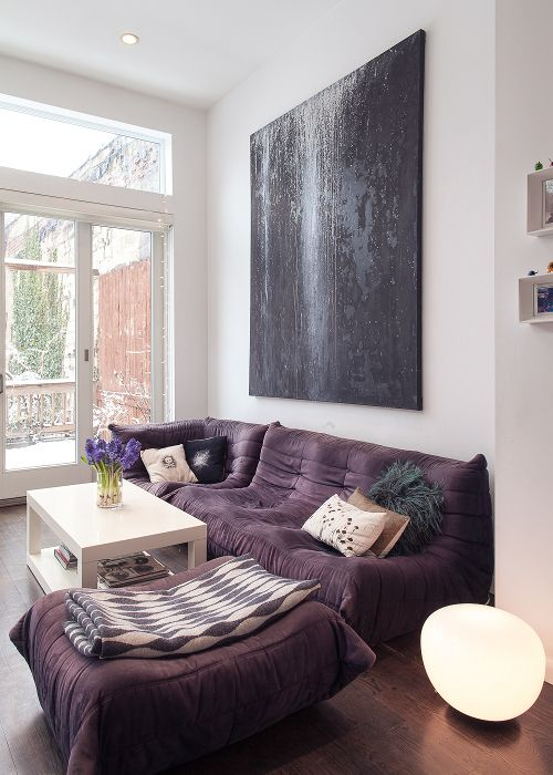 """Sneak Peek: Iwona Ludyga and Mike Mazor. """"Our living room with a Togo sofa. Felted pillows were made by a local designer. We found them at Artists and Fleas in Williamsburg."""" #sneakpeek"""