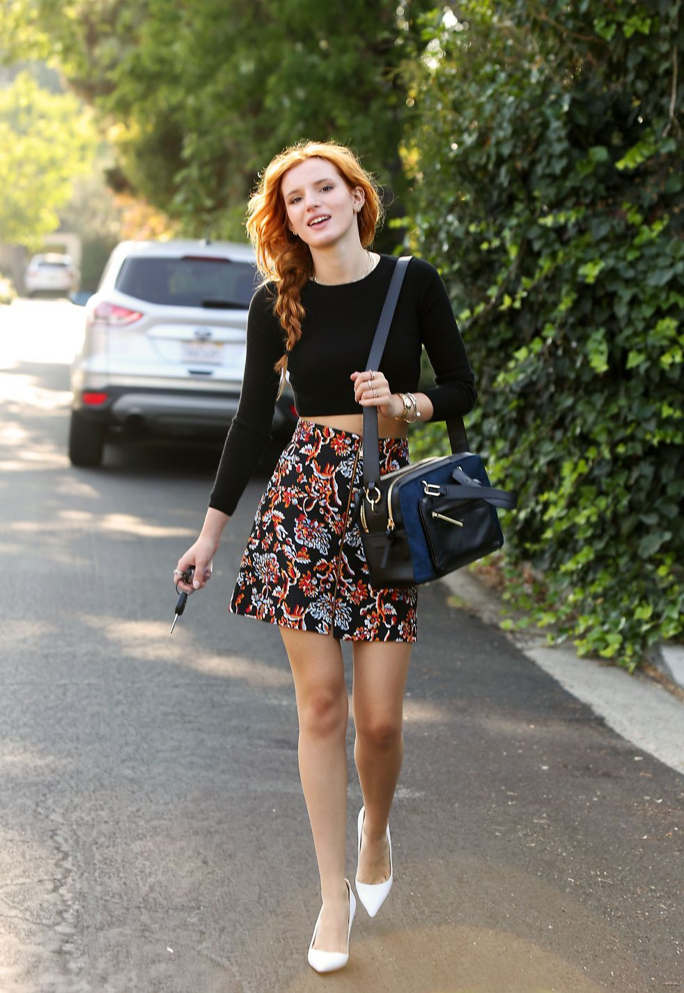 It up bella thorne sports a grown up look in elegant peplum dress - Bella Thorne Rocked A Black Knit Crop Styling It With A Floral Zara A Line Skirt An Henri Bendel Satchel And White Pumps