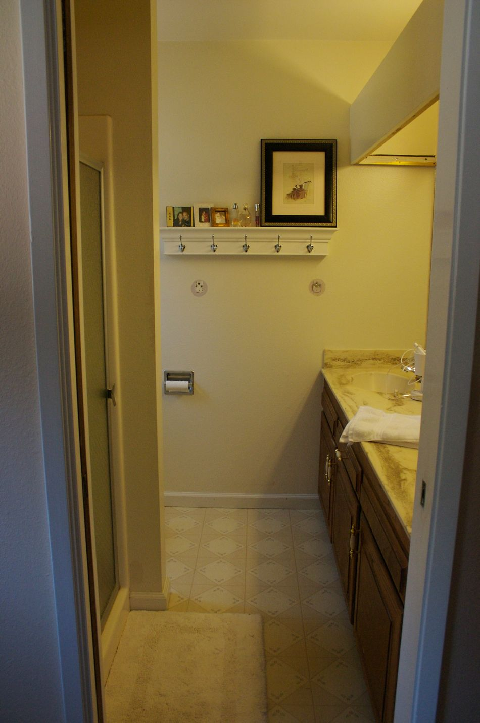 Marvelous The Original Bathroom With Vinyl Floor, Faux Marble Counter, And Old Plastic  Shower Insert