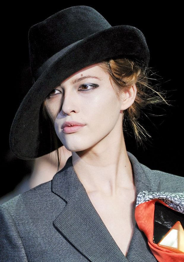 fedora hat-Giorgio Armani's tilted fedoras gave an androgynous twist to their mighty old all black felt and velvet fedoras.