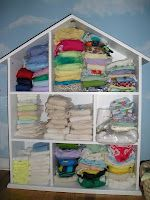 cute way to store cloth diapers :)