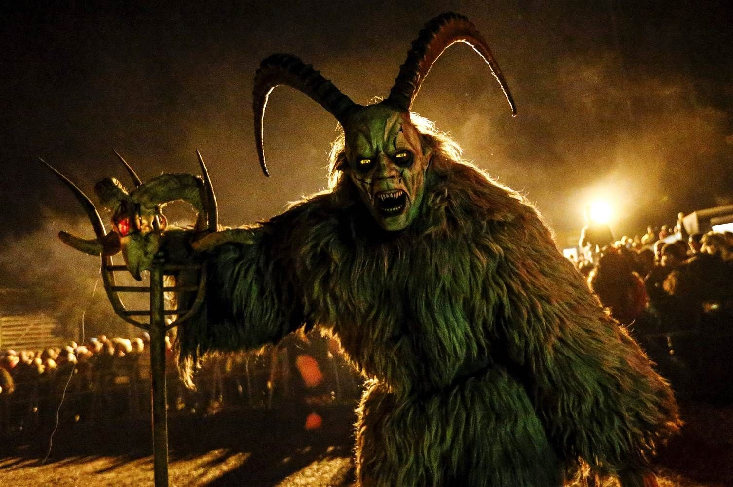 Image: Man dressed in a traditional Krampus costume and mask