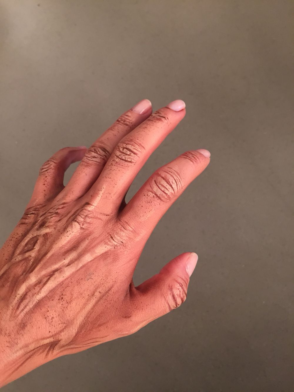 Old age effect makeup on hands, including age spots for makeup