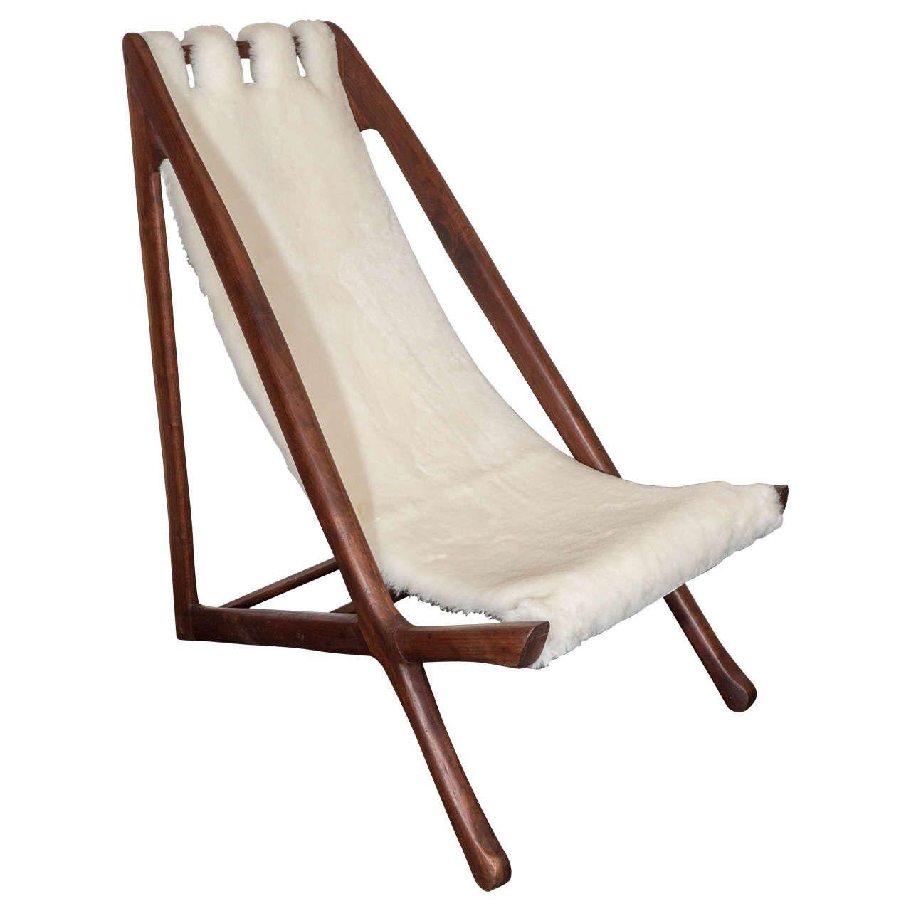 A Scandinavian Midcentury Modern Sling Chair With Sheepskin Upholstery