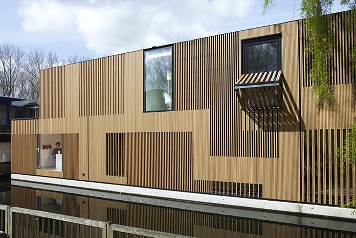 Water villa eco luxe wooden floating home in amsterdam for Architecture facade villa