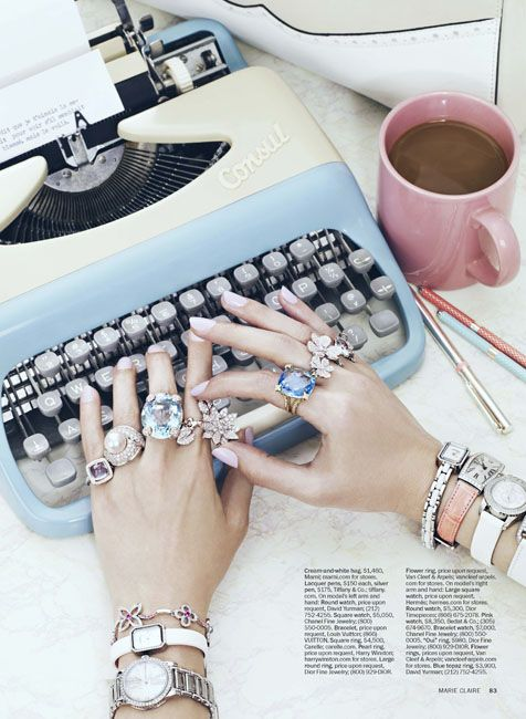 Pretty nails, pretty rings, pretty watches and pretty typewriter