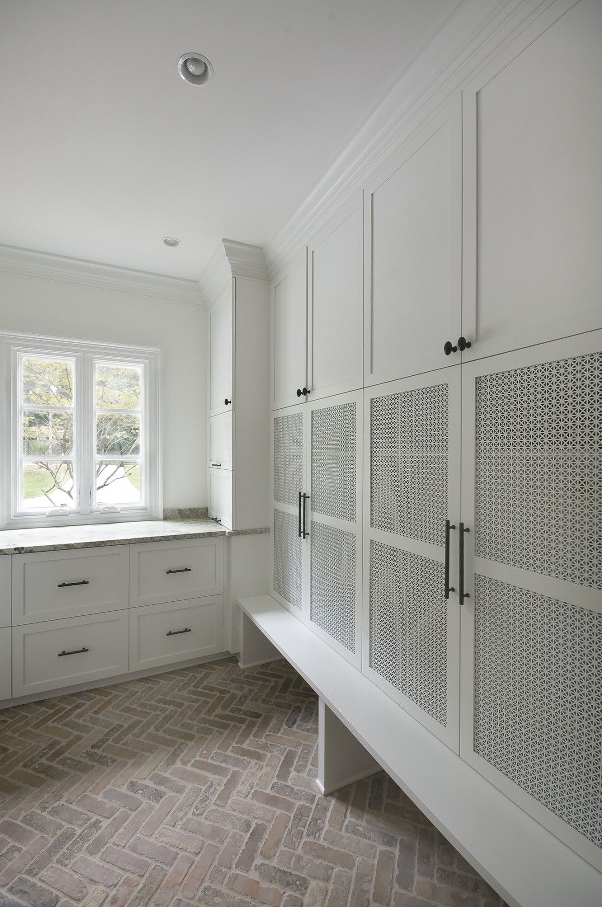 Mudroom with mesh panel in cabinet doors brick for Mudroom flooring