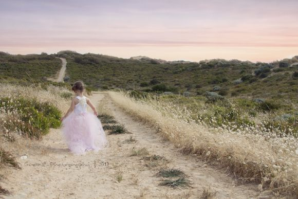 Per bridal shoot, fancy dress or styly clothes walking down road by salt