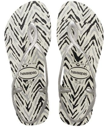 eb0f92d2a5e4f Get wild in the Havaianas Luna Animals Sandal with a trendy animal print in  an ultra comfortable cushioned footbed with signature rice pattern. This .