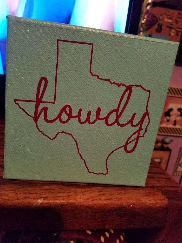 Canvas howdy sign made with a vinyl decal