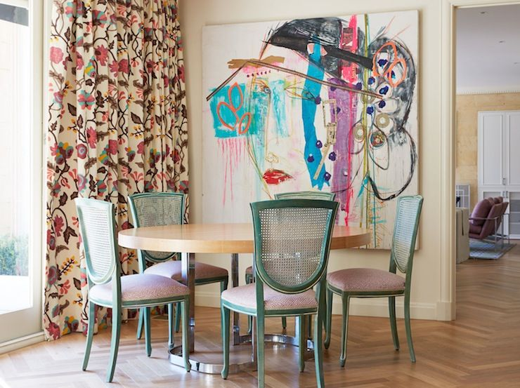 Eclectic Dining Room With Pink And Brown Floral Curtains Framing Round Blonde Wood Table