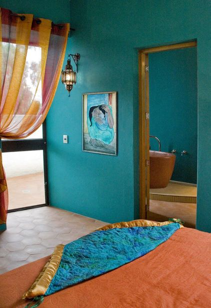 COLOR - A teal accent wall in your bedroom paired with spicy oranges and yellows creates an exotic vibe reminiscent of faraway places. Just be sure to keep the floor a light, neutral color and limit the artwork and accessories to a few key pieces, to prevent the space from feeling too busy and cluttered.