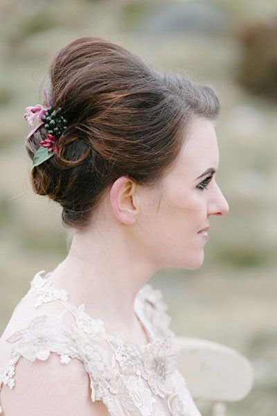 This beautiful updo featuring petals and a blackberry made us do a double-take.