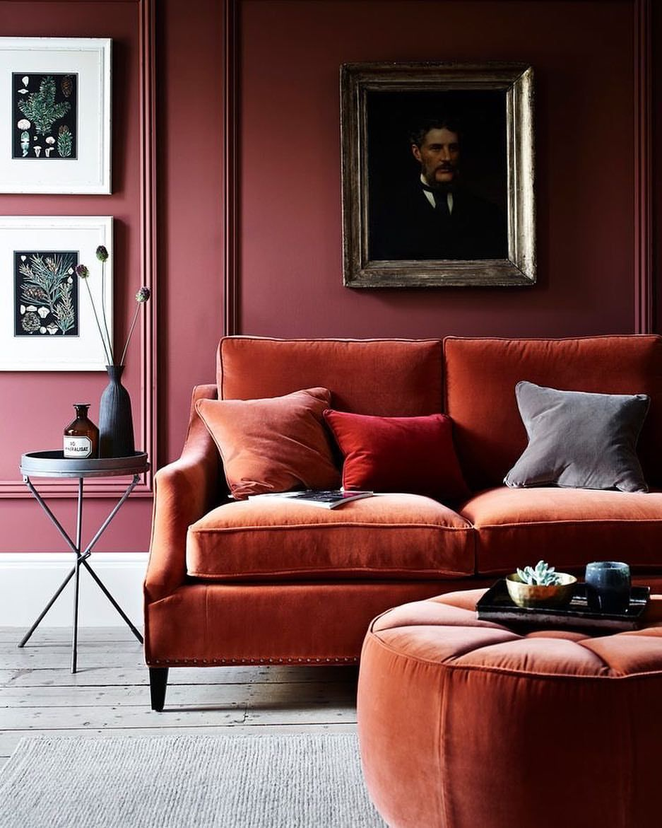 Burnt Orange Sofa Paired With Red Walls And Art. LOVE