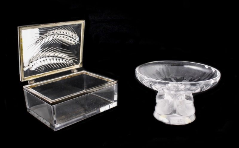 """2 Lalique Items, Wheat Epis Box & Nogent Bowl French, 20th century. Group of two Lalique art glass items comprising of a molded, frosted and clear glass bowl in """"Nogent"""" pattern with small birds resting on circular foot above rounded basin, signed on bottom """"Lalique France"""", approximate height 3.5"""", diameter 5.6""""; and a Wheat Epis or Ceres Epis lidded rectangular dresser box with silvered rims, signed on bottom """"Lalique France""""."""