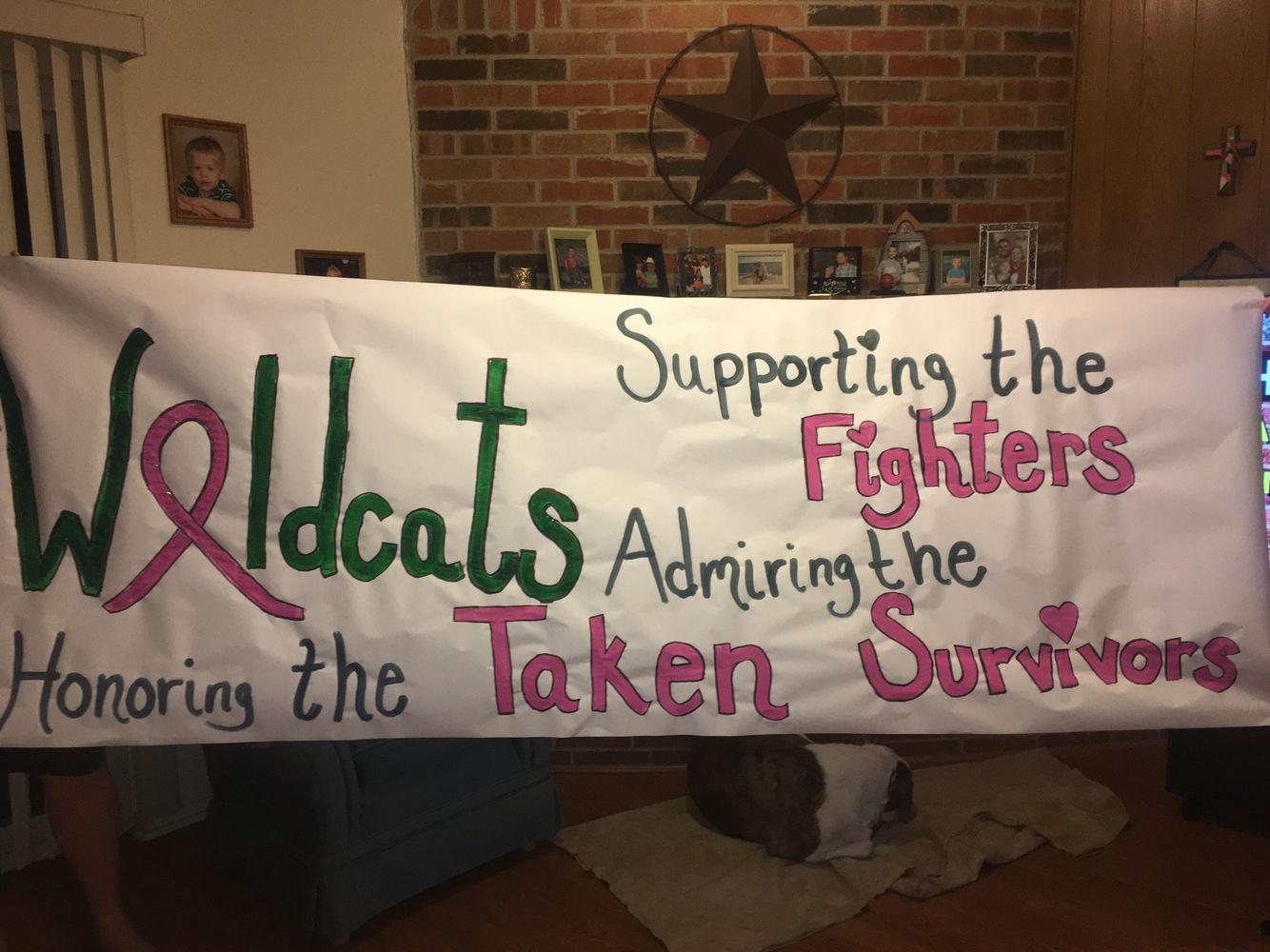 Breast cancer awareness run through football banner