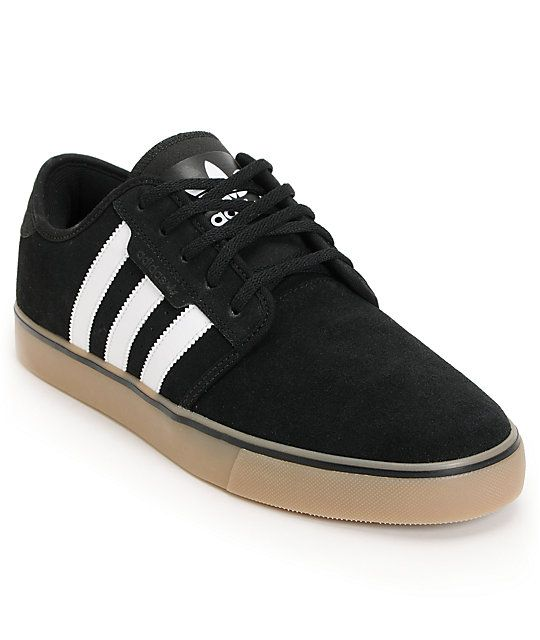 Add some style and skateability to your feet with the Adidas Seeley black  and gum suede skate shoe. These low-top suede skate shoes feature a  vulcanized gum ...