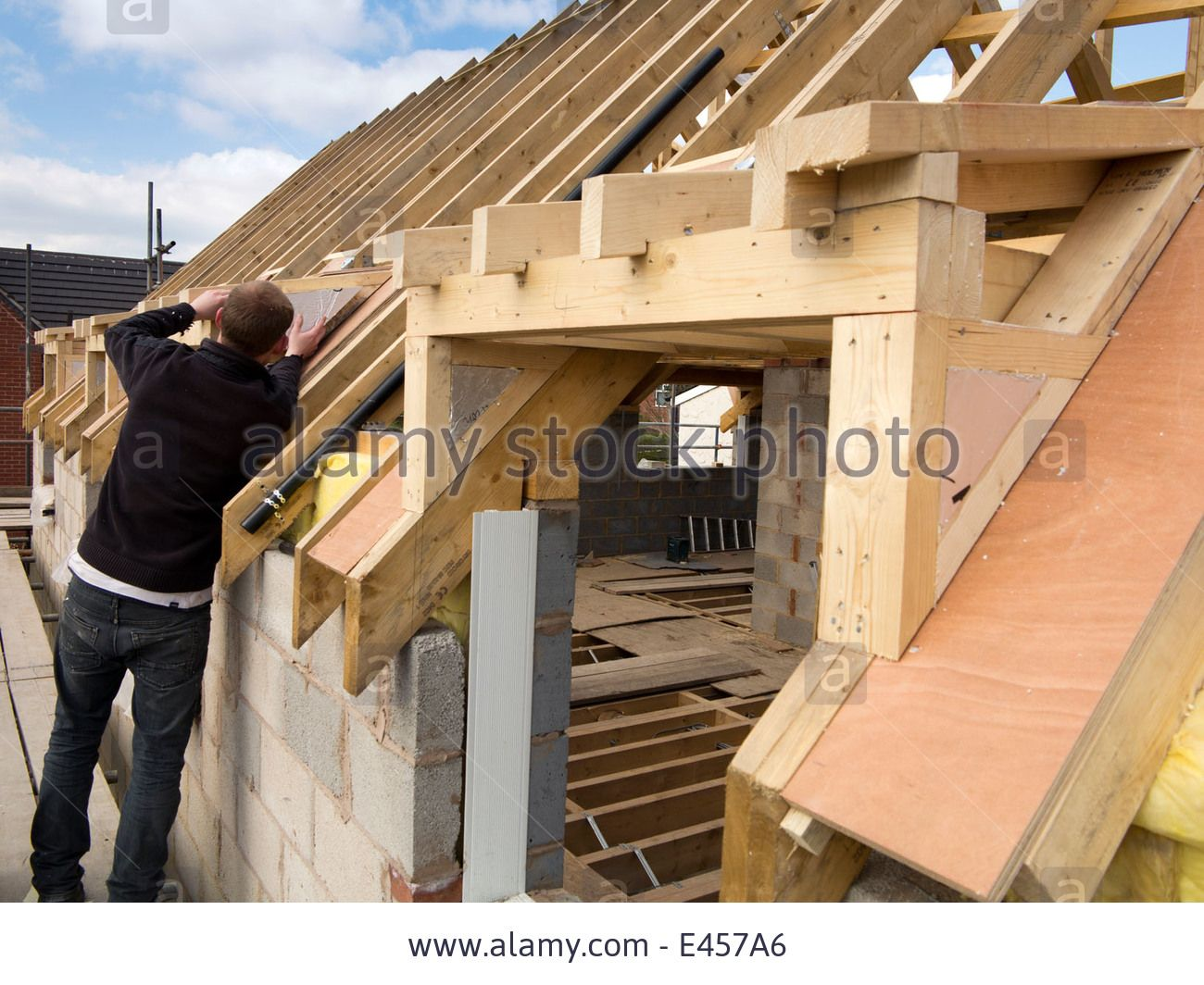Building a dormer on a house - Self Building House Constructing Roof Insulating Dormer Cheeks With Sheet Insulation Stock Photo