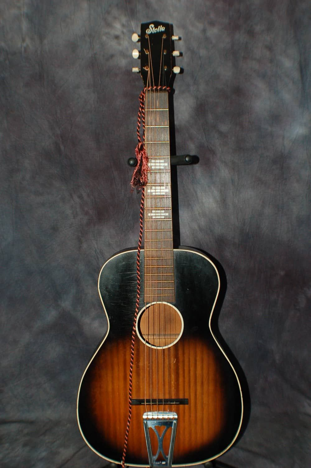 A 1940;s Harmony Made H929 Stella Guitar. This is one of the early  ones...It has the oldest painted on Stella logo, original wood nut and wood  end pin... ...