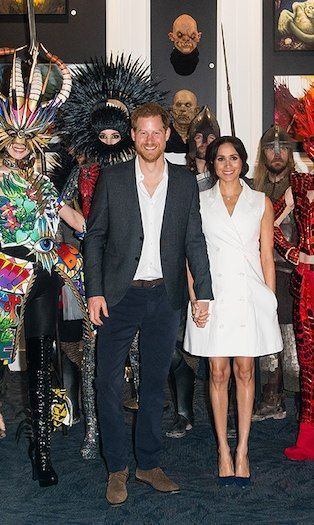 Prince Harry and Meghan Markles royal tour photos  HELLO CANADA Duchess Meghan stunned in a custom Maggie Marilyn tuxedo dress paired with her favourite Manolo Blahnik BB...