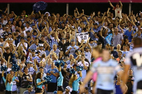News Photo: The Sharks supporters celebrate winning the round one…