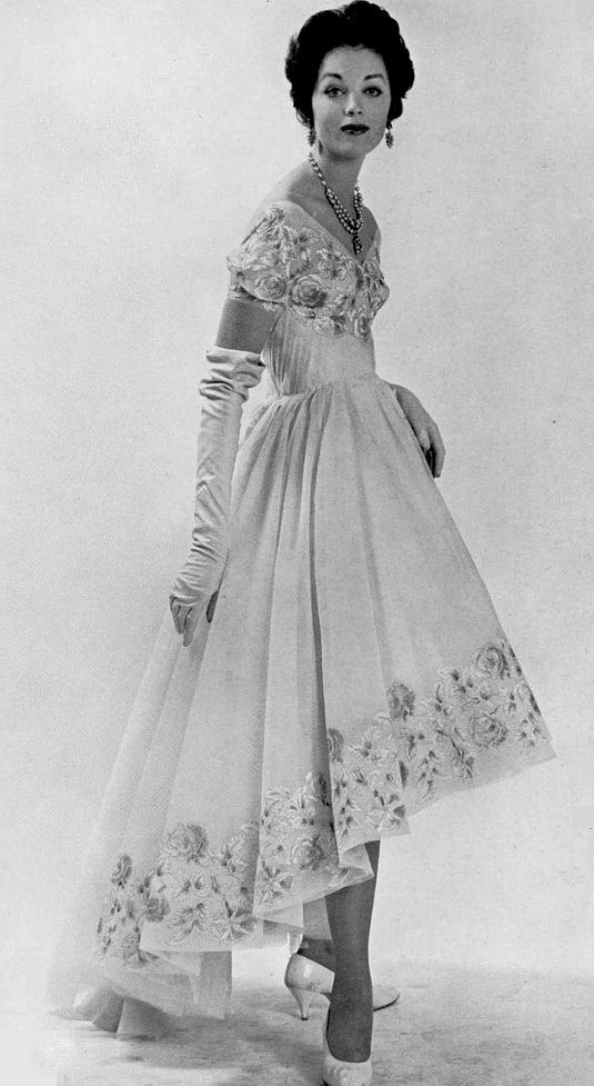1958 Model in lace embroidered evening gown by Carven, photo by Jacques Decaux