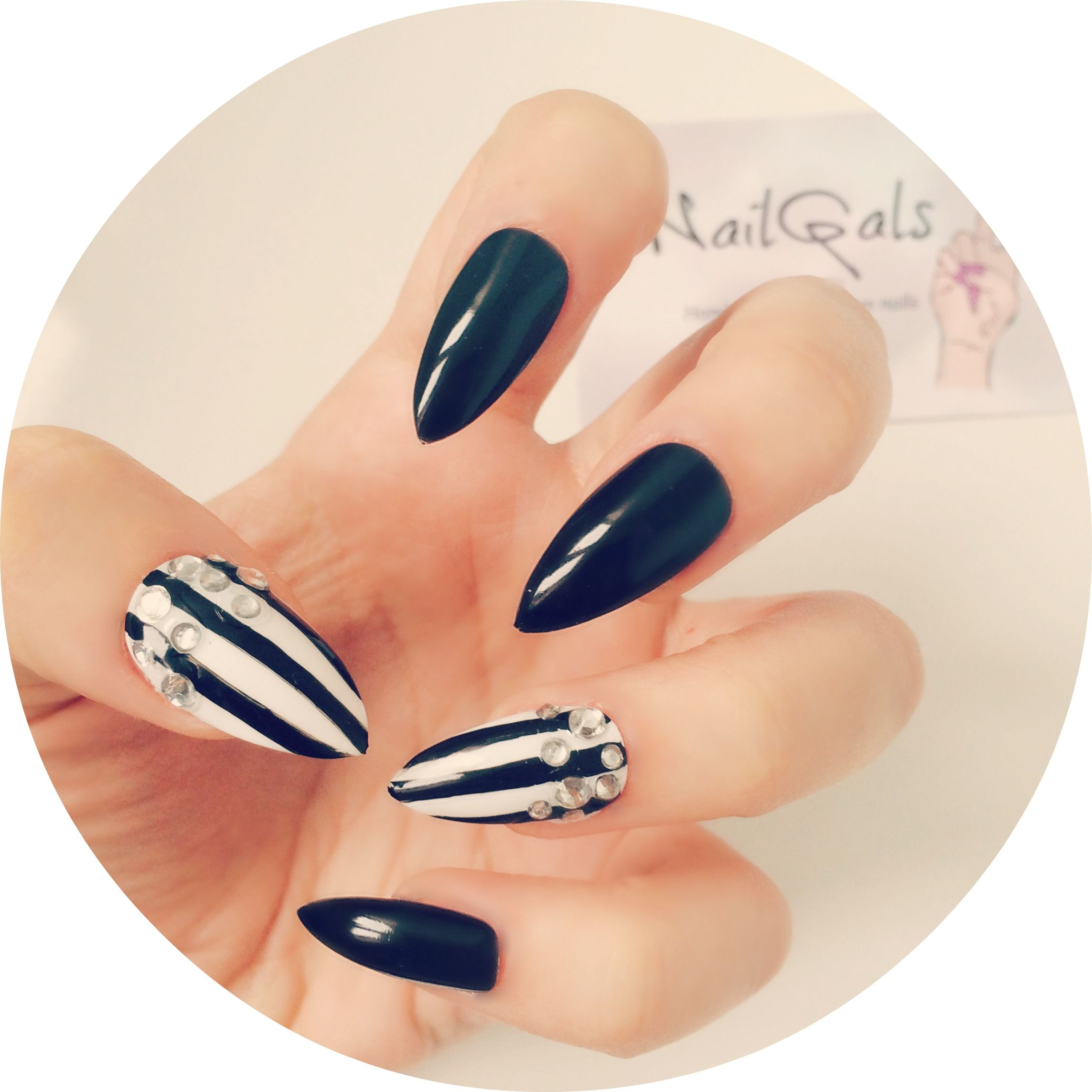 Black and white stripes with swarovski studs #stilettonails #glueonnails #pressonnails #falsenails #nailart #naildesigns #swarovski