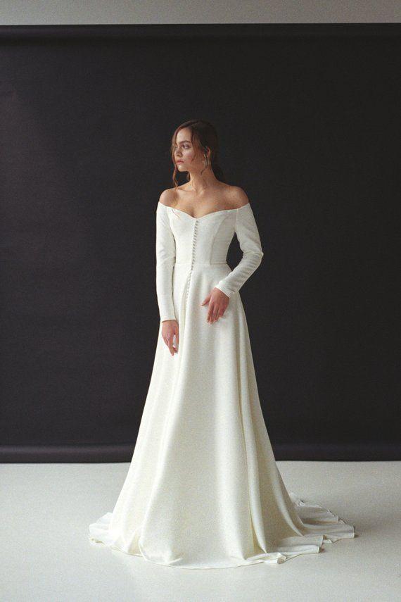 Modern off-shoulder wedding dress with a split Off-the-shoulder long sleeve crepe bridal gown Minimalist button front wedding gown SERENA #bloggonh