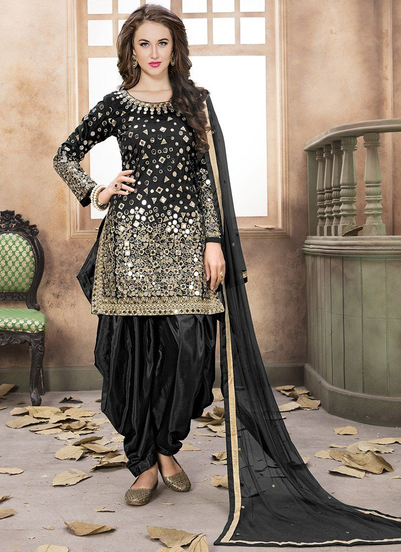 d8c7b5ab72 Black and Gold Embroidered Silk Punjabi Suit features a gorgeous silk  punjabi suit alongside a santoon inner and bottom. A net dupatta completes  the look.