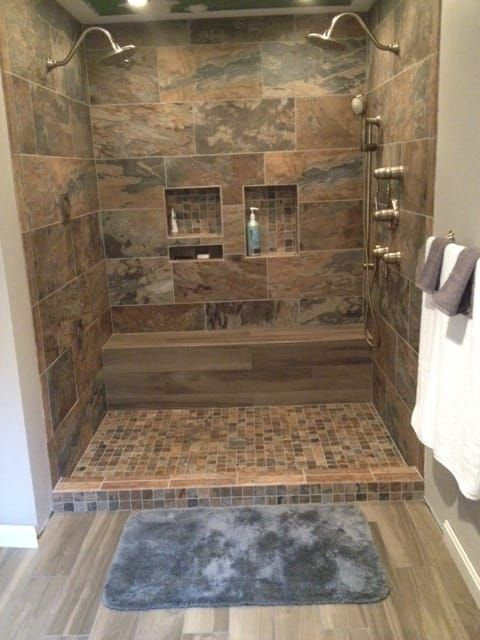 15 Bathrooms That Have Been Transformed With Wood Tile Wood Tile Shower Farmhouse Shower Shower Tile