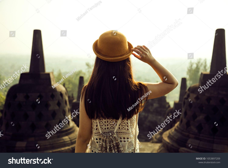 A traveller visiting borobudur temple in yogyakarta java