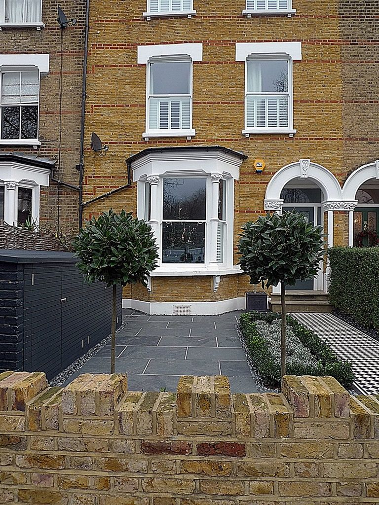 Front courtyard brick garden wall path tile grey topiary for Front garden wall ideas
