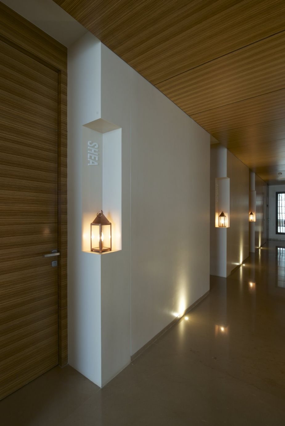 Architecture luxurious day spa interior with clean and wood accent corridor with white wall and wood ceiling and door