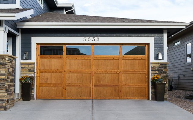 Changing Up The Exterior With Paint And A Wood Garage Door Suburban Bees Garage Doors Wood Garage Doors Garage Door Design