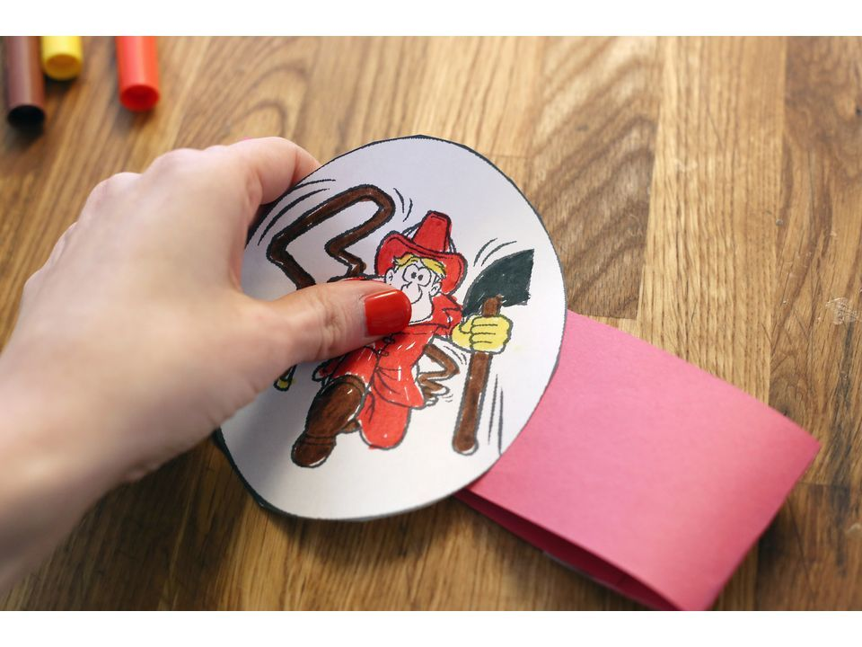 How to make a firemans hat out of construction paper