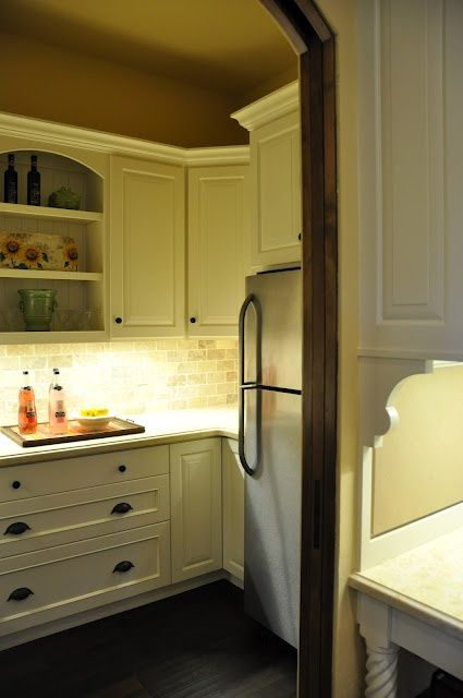 a second refrigerator tucked away in the pantry or # ...