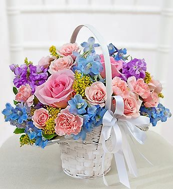 Pastel flower girl arrangement light pink roses light for Pink and blue flower arrangements