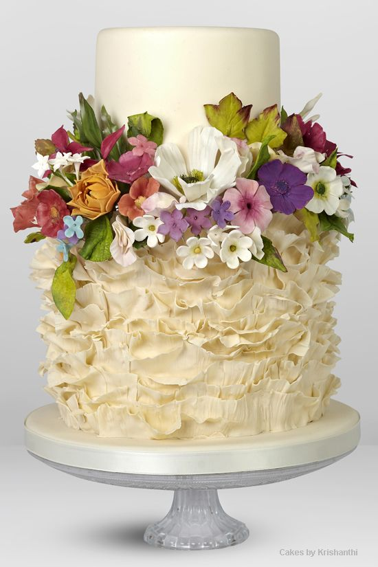 Contrast between ruffled lower cake, smooth top cake and colourful ...