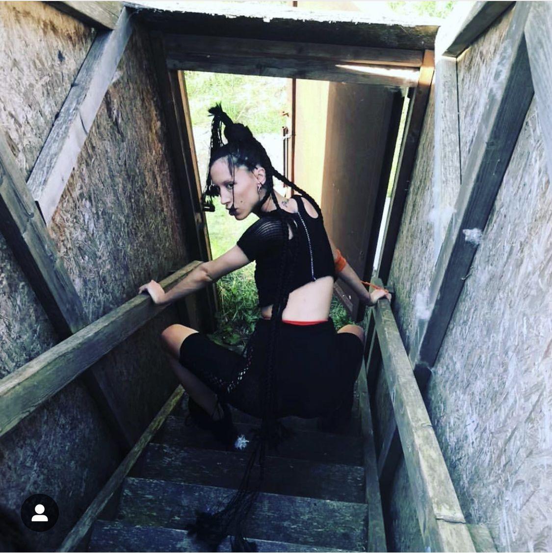 photo @lestreetedit model @besatafari  Showpiece- matalic and lycra hoody #voft #voft_knit #valeriyaolkhova #knitwear #texture #textiles #webs #unique #unconventional #concetdesign #conceptfashion #slowfashion #handcraft #domesticmachine #whomadeyourclothes #madeincopenhagen #lycra #tshirt #leggings #avantgarde #bodycon #dark #underwear #red #hair #handplait #long