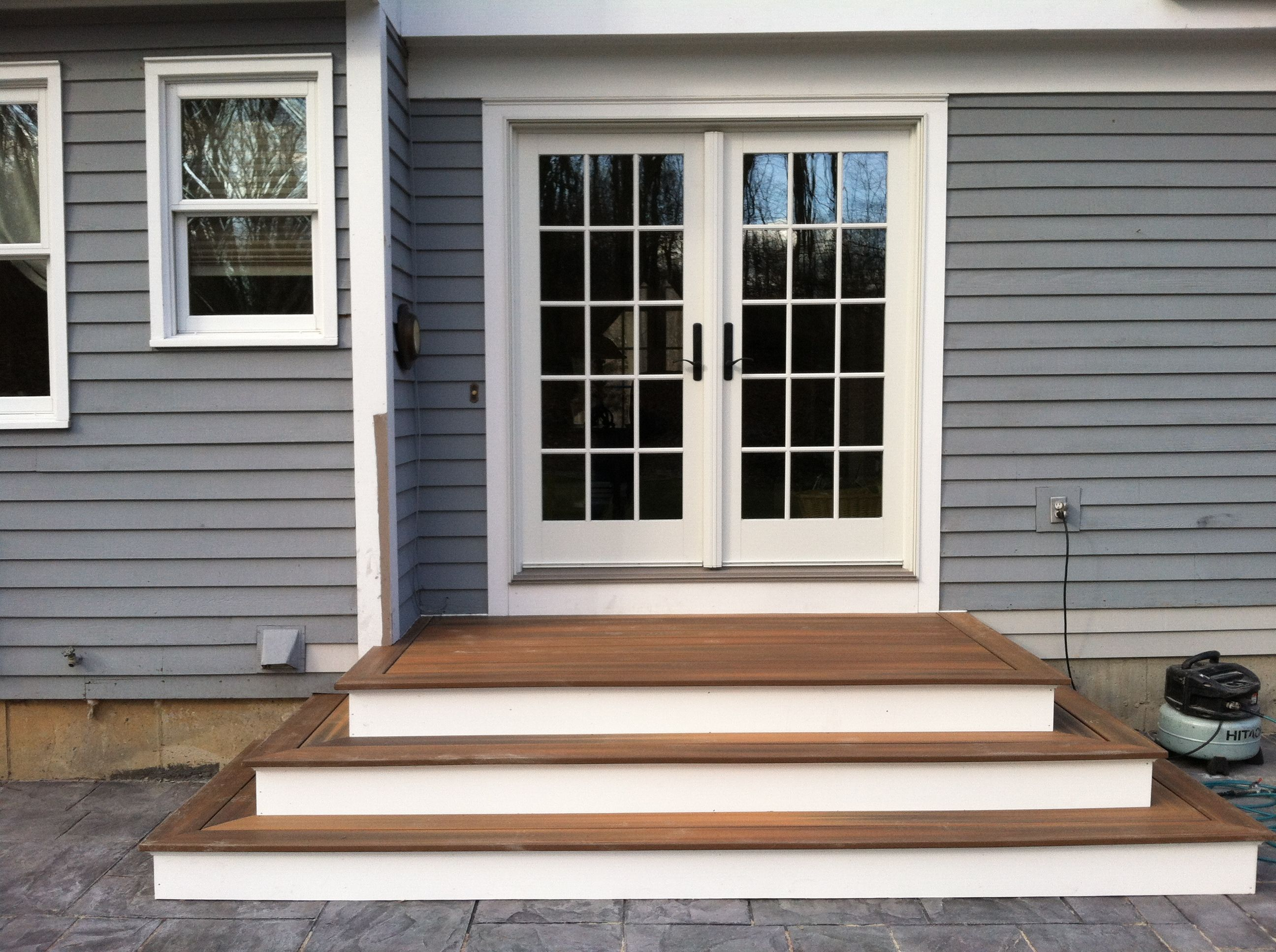 Steps to patio back door we recently finished the steps for French doors back porch