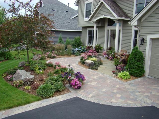 Unique hardscape front provided by abundant lawn for Unique front yard landscaping ideas