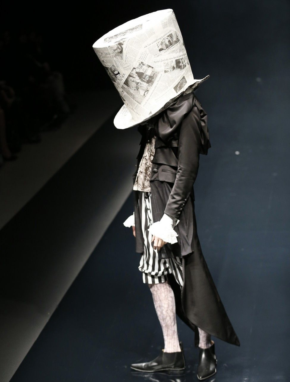 A model displays a creation of designer yasutaka funakoshi Japanese clothing designers