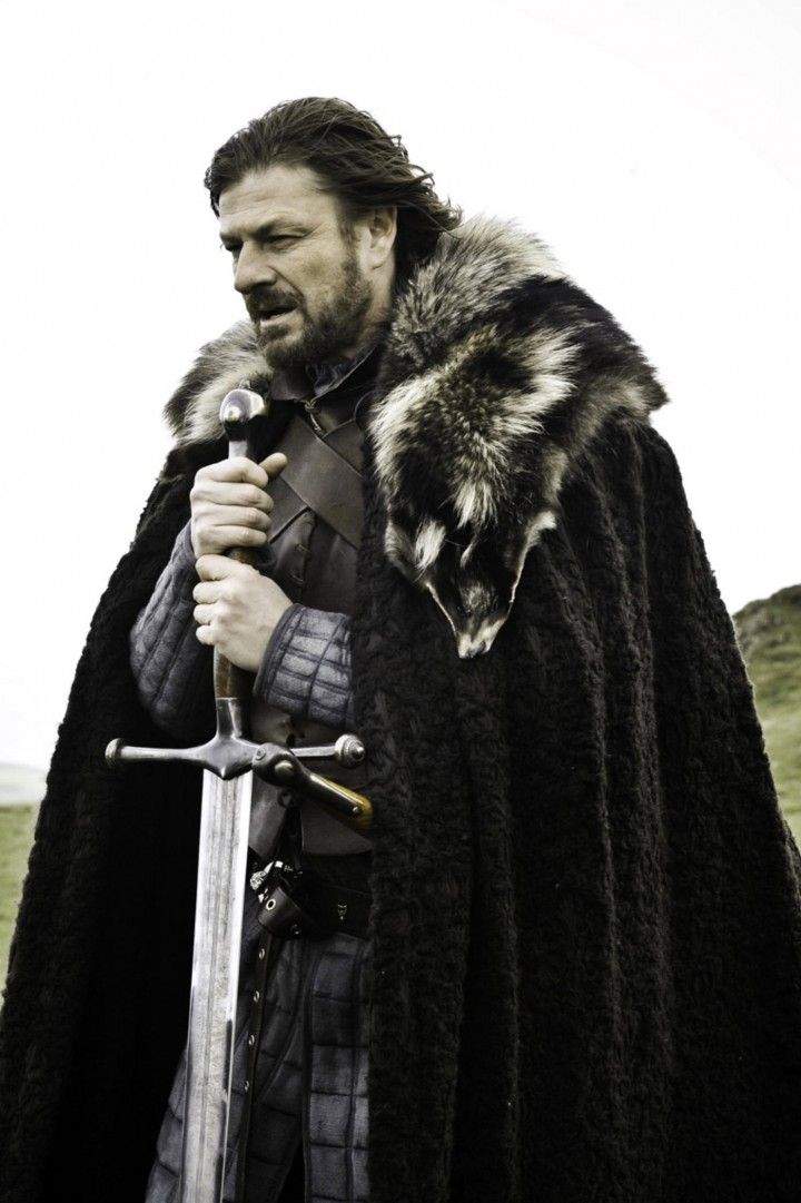 Sean Bean as Eddard Stark in Game of Thrones. Falsely accused as a traitor and beheaded.