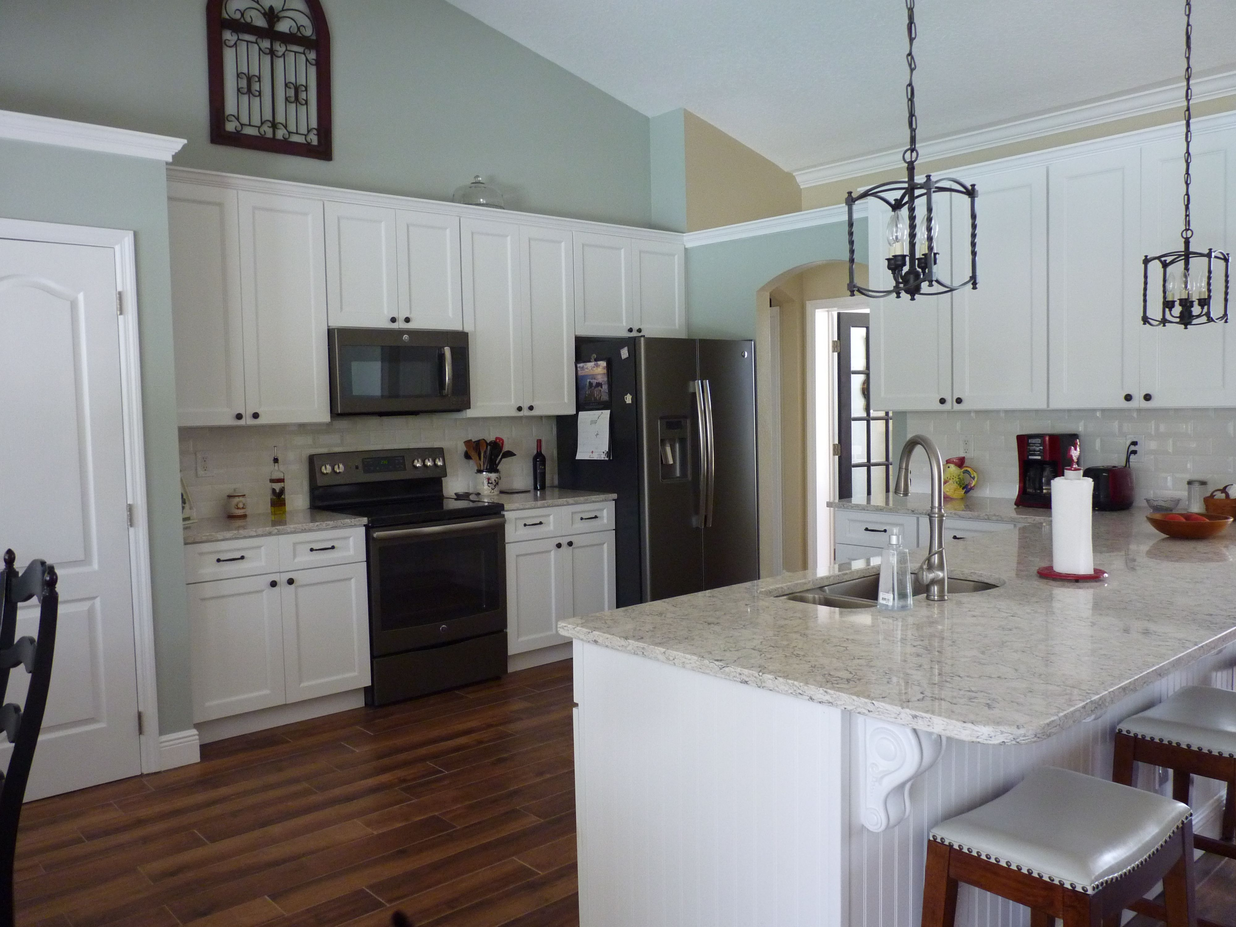 My new Kitchen! GE Slate appliances. Aria quartz from Home Depot ...
