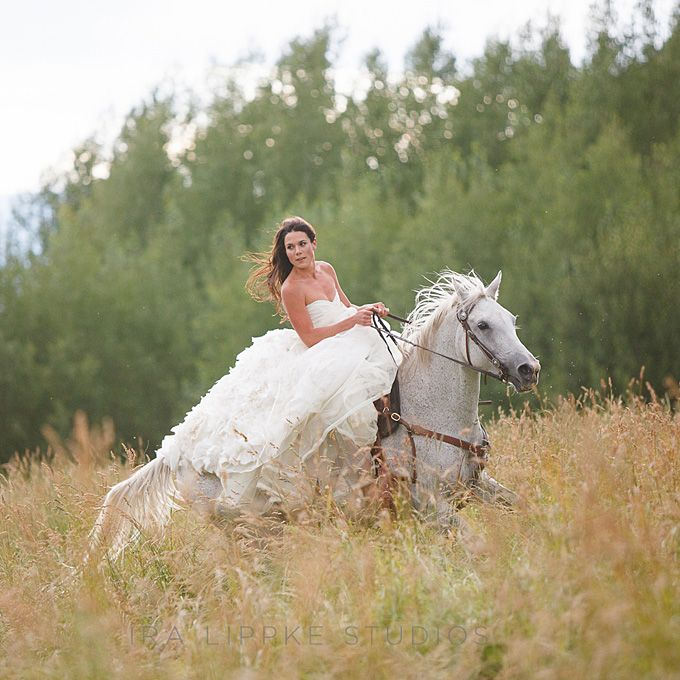 Brides.com: Wedding Dresses for a Destination Wedding. A Full Floral Wedding Dress for an Aspen Affair. Between the beautiful horse the bride is riding and her heavily textured skirt, this ruffled dress is dripping with western glam.   Browse more rustic Colorado weddings.